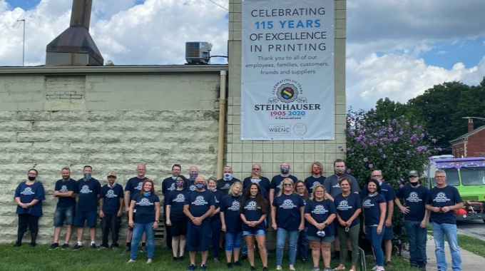 Tara Halpin (front, center) and the Steinhauser team celebrating 115 years in business