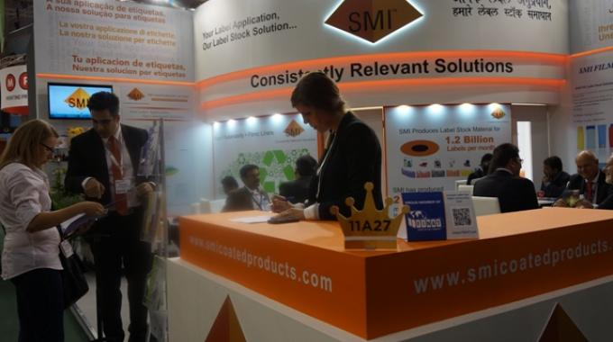 Rohit Mehta, director at SMI Coated Products in discussion with visitors during Labelexpo Europe 2015