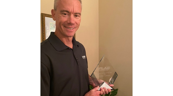 Mike Agness, Hybrid Software's executive vice president in the Americas with the FLAG award