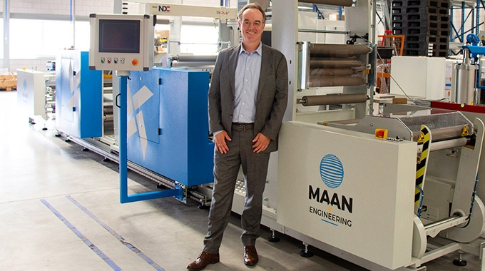 Robert Bongertman, commercial director at Belona in a front of the recently installed Linerless Label Line from Maan Engineering