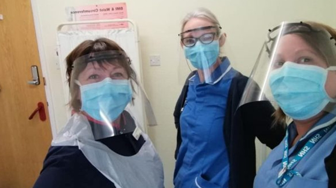 NHS staff at Chesterfield Surgery wearing face shields produced by Rollem