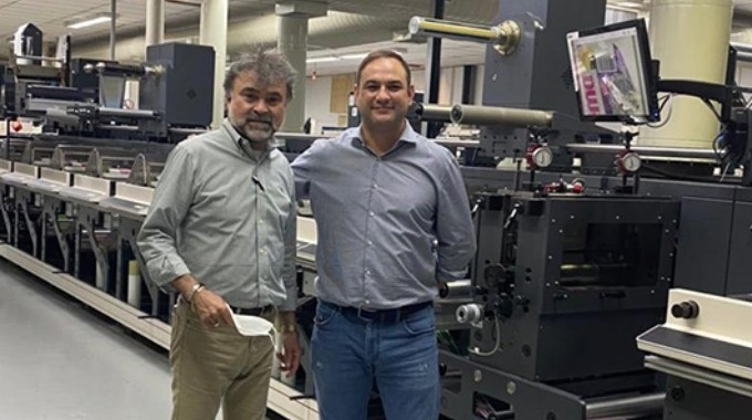 Francisco Paz, owner of Grif, poses with Rubens Wilmers of Nilpeter Brasil, in front of one of the new Nilpeter FA-17 presses