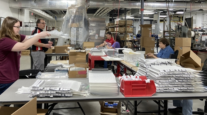 Employees at Metalcraft in Mason City, Iowa, work to assemble critical PPE