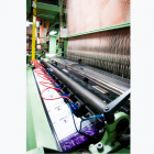Wright Global Graphics uses a powered loom for its woven labels