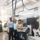 Hemanth Paruchuri (left) of Pragati Pack with Sunil Talpade (center) of Royal Coat with the new Digifast One finishing machine