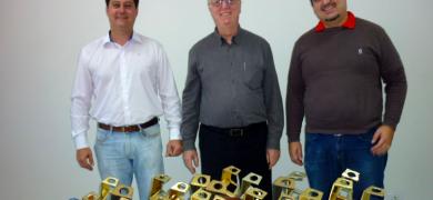 L-R: Fernando Rizzieri, R&D director; José Carlos Rizzieri, CEO; Bruno Rizzieri, supply manager, with Gráfica Rami's multiple Fernando Pini awards