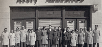 Stan Avery and his employees stand in front of the Fourth Street location to which the company moved in 1940