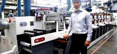 Trisan Printing managing director Piyapong Wongvorakul with the company's new Nilpeter press