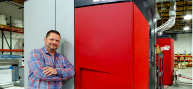 Ramon Fernandez, owner of ProLabel in Miami, Florida, stands by the Xeikon 3030 press that jumpstarted his foray into digital printing