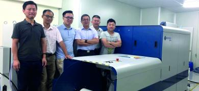 The Fengpeng team with the Domino N610i inkjet press