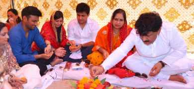 Kuldip Goel, with his family, performing Indian rituals before the construction of his new factory.