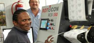 Win-Pak print manager Basil Forbes (left) with the company's new Rotocon Ecoline RCSI 330 slitter rewinder