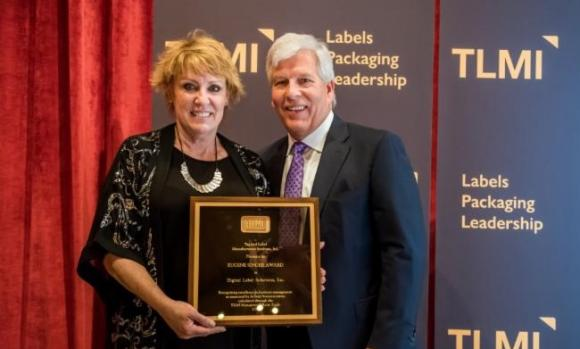 Sandy Petersen of Digital Label Solutions accepts the Eugene Singer Award from TLMI chairman Craig Moreland.