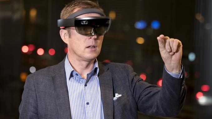 Sovelto's Jari Kotola using HoloLens to select unique QR codes generated by Magic Add | Picutre credit: Sovelto