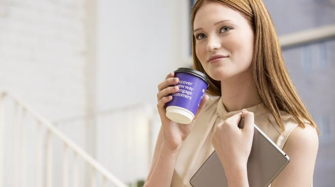 Single-use paper cup 'perfect' for smart device centered promotional campaigns as consumers interact with a coffee cup for several minutes at a time and pay attention to what is printed on it
