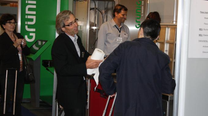 Christoph Schönenberger, Nanovis sales manager, promoting the Nanocleaner NWC-1200 at Labelexpo Europe 2013