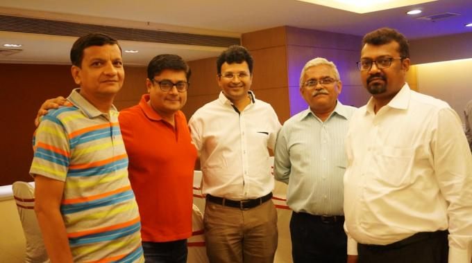 Manish Kapoor, country manager of sales at Nilpeter (second from left) and Mehul Shah, president of Vadodara Association of Master Printers (center) seen networking after the event
