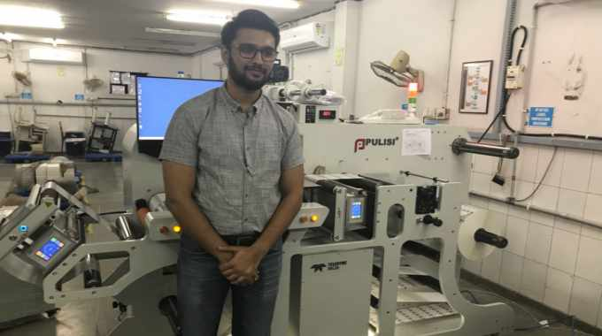 Heman Vasa of Unick Fix-a-Form with the new Pulisi finishing machine at his factory