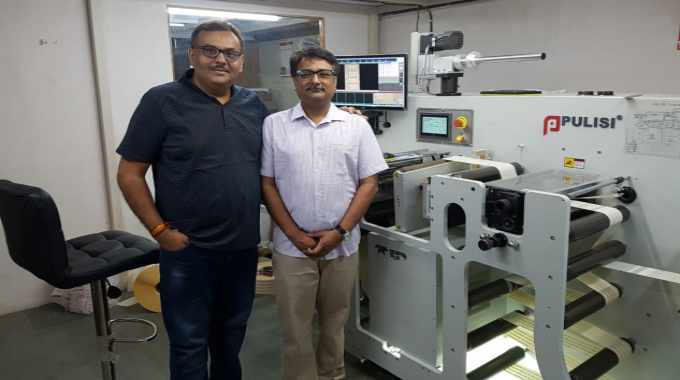 Amit Sheth of Intergraphic with Rajan Vyas of Nitai Press with the new Pulisi machine at the factory in Ahmedabad