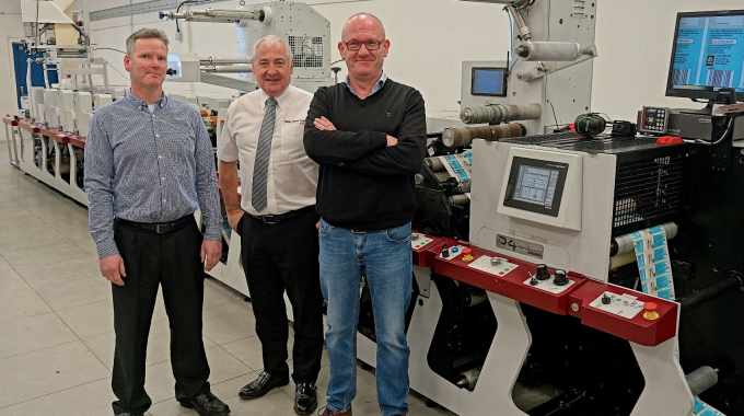Declan Boran (left), Paul Macdonald (middle) and Ian Bowden with HB Label Print's new P4 - Mark Andy's first press in Ireland with UV LED curing