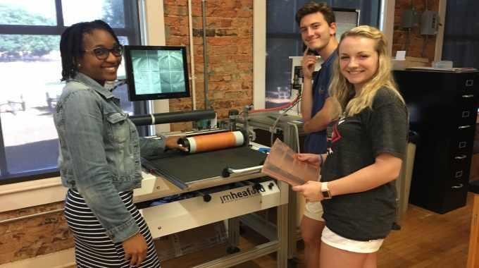 Clemson University students with the JM Heaford FTS plate mounter