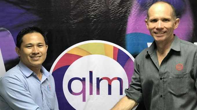 Sokun Tep (left) and Simon Pugh (right) celebrate the opening of QLM Label Makers' new facility in Cambodia